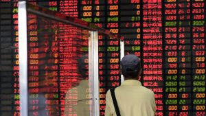 Beijing has submitted a draft amendment to facilitate the entry of foreigners into the capital of Chinese listed companies.  AFP PHOTO / JOHANNES EISELE / AFP PHOTO / JOHANNES EISELE